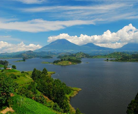 Scenic view of Lake Mutanda and the Virunga Mountains.
